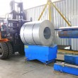Machine for rolling steel sheet in wareh - Stock Photo
