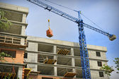 Construction building with crane — Stock Photo