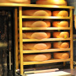 Round stacks of cheese stored — Stock Photo #1988568