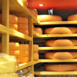 Round stacks of cheese stored — Stock Photo