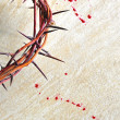 Crown of thorns with blood on grungy bac - Stock Photo