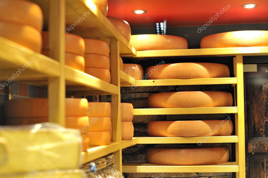 Round stacks of cheese stored — Stock Photo #1988600