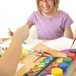 Cute little girl painting with watercolo — Stock Photo