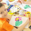 Stock Photo: Boy painting with watercolor