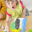 Girl painting with watercolor — Stock Photo #2014361