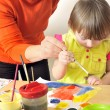 Mother painting with her daughter — Stock Photo