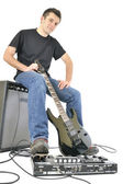 Young with guitar and an amplifier — Stock Photo