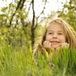 Little girl on grass — Stock Photo #2023805