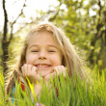 Little girl on grass — Stock Photo #2023860