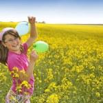 Girl on field — Stock Photo