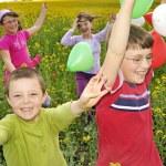 Playfulness kids on field — Stock Photo