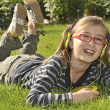 Girl listening music in headphones — Foto de Stock