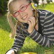 Royalty-Free Stock Photo: Little fun girl listening music in headp