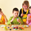 Kids painting eggs — Stock Photo