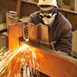 Worker using torch cutter to cut through — Stock Photo