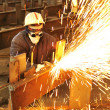Stock Photo: Worker using torch cutter to cut through