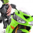 Royalty-Free Stock Photo: Motorcycle gloves with carbon and bike