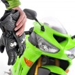 Motorcycle gloves with carbon and bike - Stock Photo