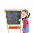 Little girl and blackboard — Stock Photo #2606916