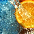 Orange flows water — Stock Photo