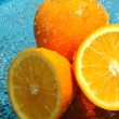 Beauty fresh orange in water — Stock Photo