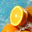 Water flows on a orange — Stock Photo