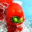 Beauty red peppers in water — Stock Photo