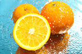 Fresh orange in water — Stock Photo