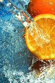 Orange flows water — Stock Photo