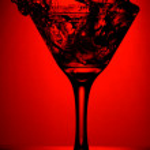 Red martini splash — Stock Photo