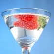 Strawberry with martini glass blue — Stock Photo #2402340