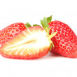 Three strawberry on a white - Stock Photo