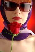 Young girlp portrait with red rose — Stock Photo