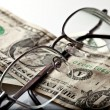 Glasses on money - Stock Photo