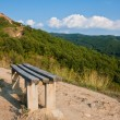 Bench on a Mountain Path — Stock Photo