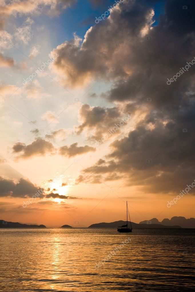 Sailboat at sunset in the Andaman Sea, Thailand.  Stock Photo #2608604