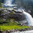 Waterfall flowing, Austria - Stock Photo