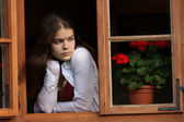 Girl in the window — Stock Photo