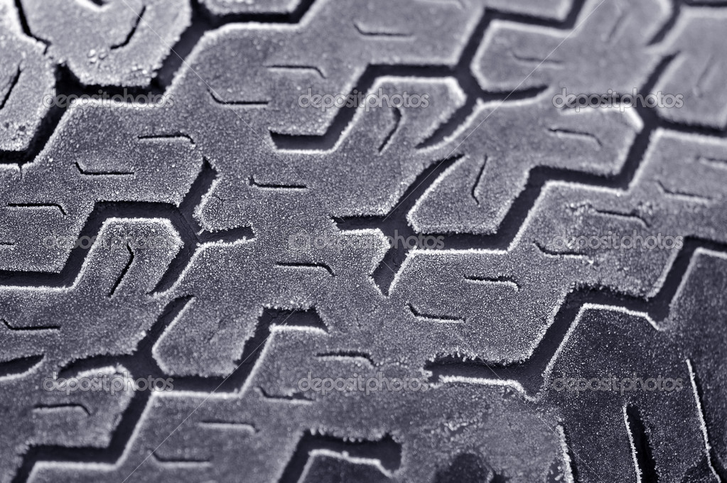 Winter frost on worn car tire  Stock Photo #2028554