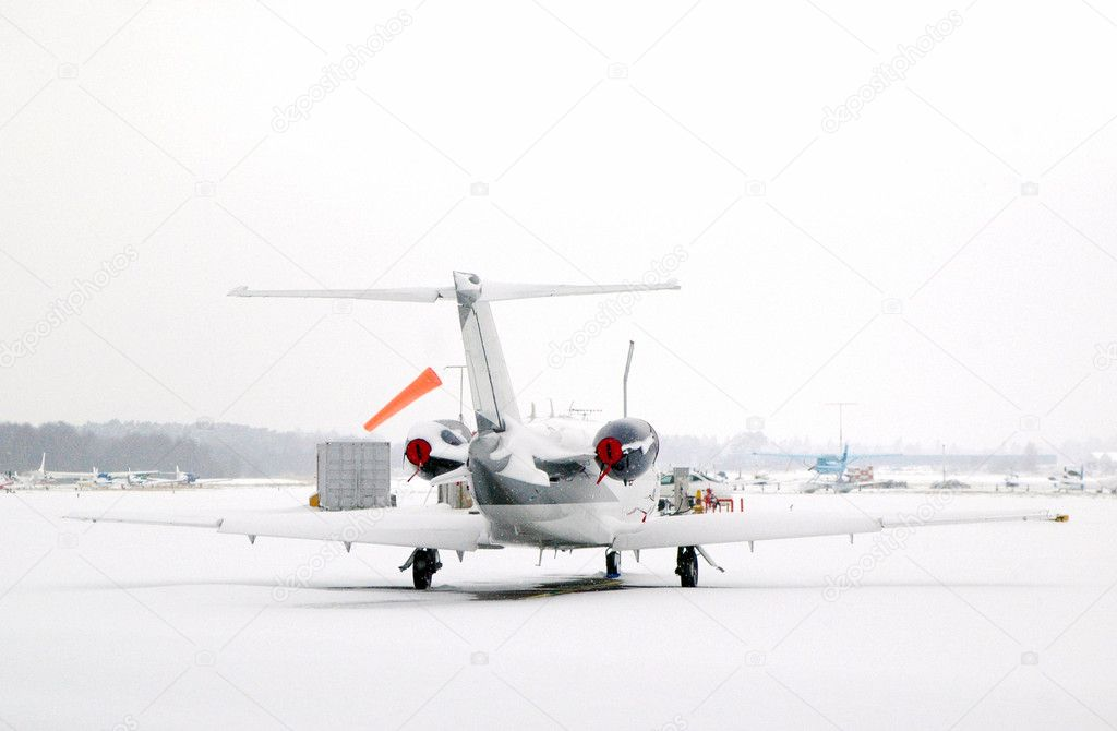 Business jet snowed in at an airport — Stock Photo #2049861