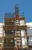 Construction scaffolding covering a building exterior — Stock Photo