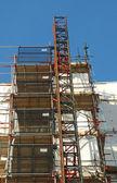 Construction scaffolding covering a building exterior — Stock Photo