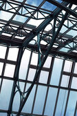 Light from a cloudy blue sky through building windows — Stock Photo