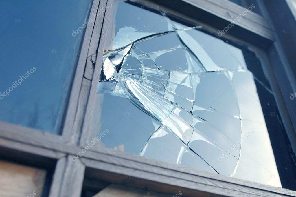 Broken window reflecting blue sky — Stock Photo #2072419