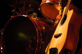 Drums and guitar — Stock Photo