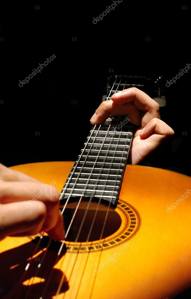 Abstract of a musician playing a spanish style guitar — Stock Photo #2117107