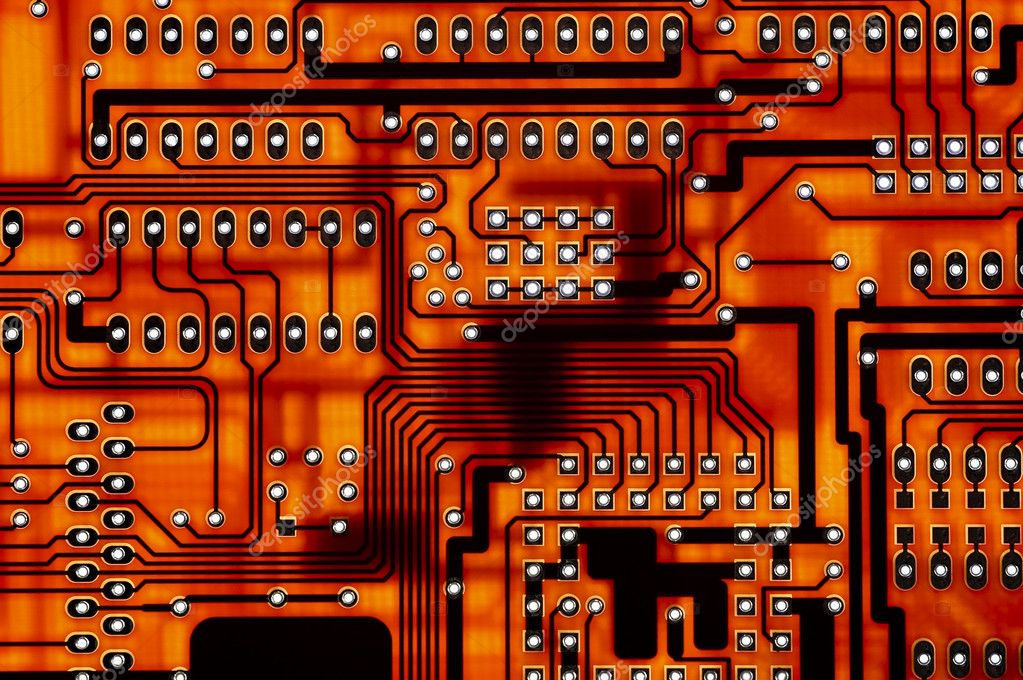 Close-up of red computer circuitboard solder tracks and holes  Stock Photo #2120402