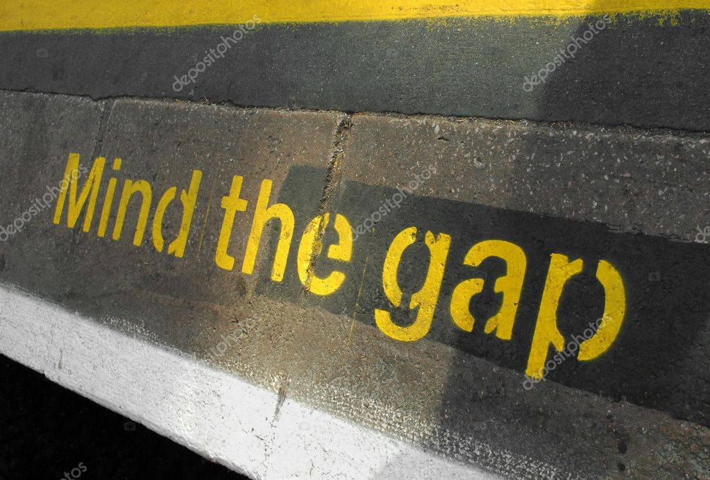 Mind the gap sign on a railway or subway platform  Stock Photo #2195528