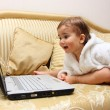 Royalty-Free Stock Photo: Baby boy with laptop on sofa