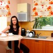 Stockfoto: Young womon kitchen